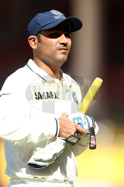 Virender Sehwag of India leaves the field for tea during day 1 of the first test match between India and New Zealand  held at the Sardar Patel Gujarat Stadium in Ahmedabad on the 4th November 2010..Photo by Ron Gaunt/BCCI/SPORTZPICS