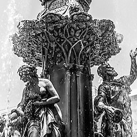 Cincinnati fountain vertical panorama picture in black and white. Panorama photo ratio is 1:3. The fountain is named The Genius of Water by Tyler Davidson and is located in Fountain Square in downtown Cincinnati, Ohio. The Tyler Davidson fountain is one of the city's most popular attractions.