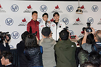 KELOWNA, BC - OCTOBER 26: Mens long program gold medalist, Japanese skater Yuzuru Hanyu (c), silver medalist, Canadian figure skater Nam Nguyen (l) and bronze medalist, Japanese skater Keiji Tanaka (r) stand on the podium during a press conference at Prospera Place on October 26, 2019 in Kelowna, Canada. (Photo by Marissa Baecker/Shoot the Breeze)