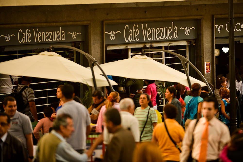 "Cafe Venezuela, a state-owned coffee shop that sells government subsidized coffee in a building expropriated on a whim by President Hugo Chavez in downtown Caracas. The Chavez government has launched a nationwide campaign to crack down on over-pricing and hording the government blames for shortages of basic goods, such as coffee. The National Guard regularly inspects grocery stores and distributors' storage facilities, often televising raids. Chavez has also accelerated the nationalization of farms and food industries, including many coffee plantations and coffee-producing companies. Since taking office in 1999, he has seized more than 1,000 companies or assets. ""Destroying domestic production and expropriating companies makes you inefficient, dependent on imports and scares off investment -- there's no way the economy won't explode,"" said Luis Vicente Leon, head of Caracas-based polling firm Datanalisis."