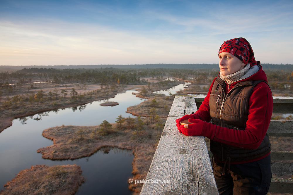 Young Woman Looking over Männikjärve Bog, Jõgeva County, Estonia