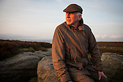 Head gamekeeper at Bolton Abbey Estate, Paul Wilby, at dawn on the grouse moor.