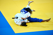 Warsaw, Poland - 2017 April 21: Katarzyna Klys from Poland (white) competes with Marie Eve Gahie from France (blue) in the women's 70kg bronze medal fight during European Judo Championships 2017 at Torwar Hall on April 21, 2017 in Warsaw, Poland.<br /> <br /> Mandatory credit:<br /> Photo by © Adam Nurkiewicz / Mediasport<br /> <br /> Adam Nurkiewicz declares that he has no rights to the image of people at the photographs of his authorship.<br /> <br /> Picture also available in RAW (NEF) or TIFF format on special request.<br /> <br /> Any editorial, commercial or promotional use requires written permission from the author of image.
