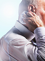 Middle Aged Businessman wiping sweat from back of neck close-up side view