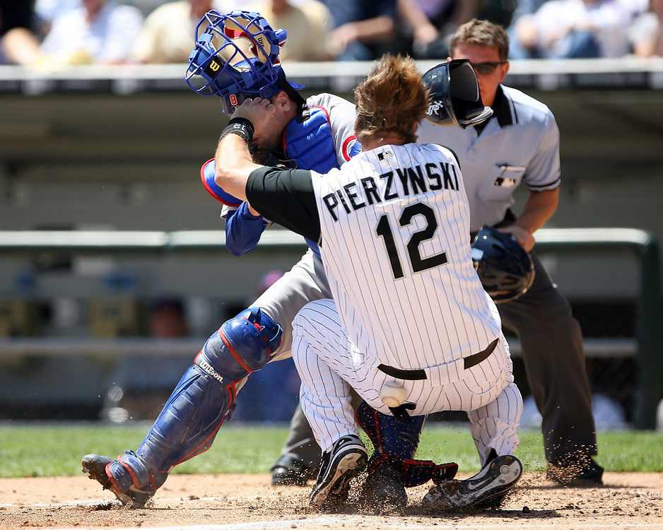CHICAGO, IL-MAY 20:  A.J. Pierzynski of the Chicago White Sox collides with catcher Michael Barrett of the Chicago Cubs during the game at U.S. Cellular Field on May 20, 2006. (Photo by Ron Vesely)