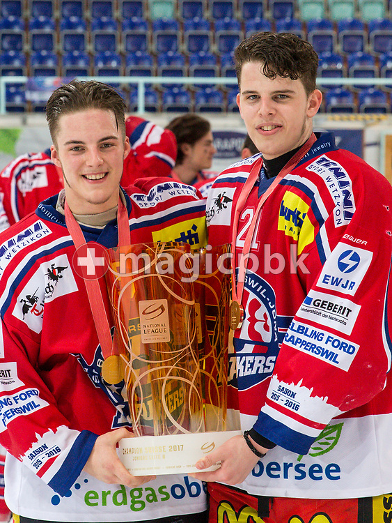 (L-R) Rapperswil-Jona Lakers defenseman Janis Manser and Antoine Janssen pose for a photo with their gold medals and the Swiss Champion trophy after winning the fifth Elite B Playoff Final ice hockey game between Rapperswil-Jona Lakers and ZSC Lions held at the SGKB Arena in Rapperswil, Switzerland, Sunday, Mar. 19, 2017. (Photo by Patrick B. Kraemer / MAGICPBK)