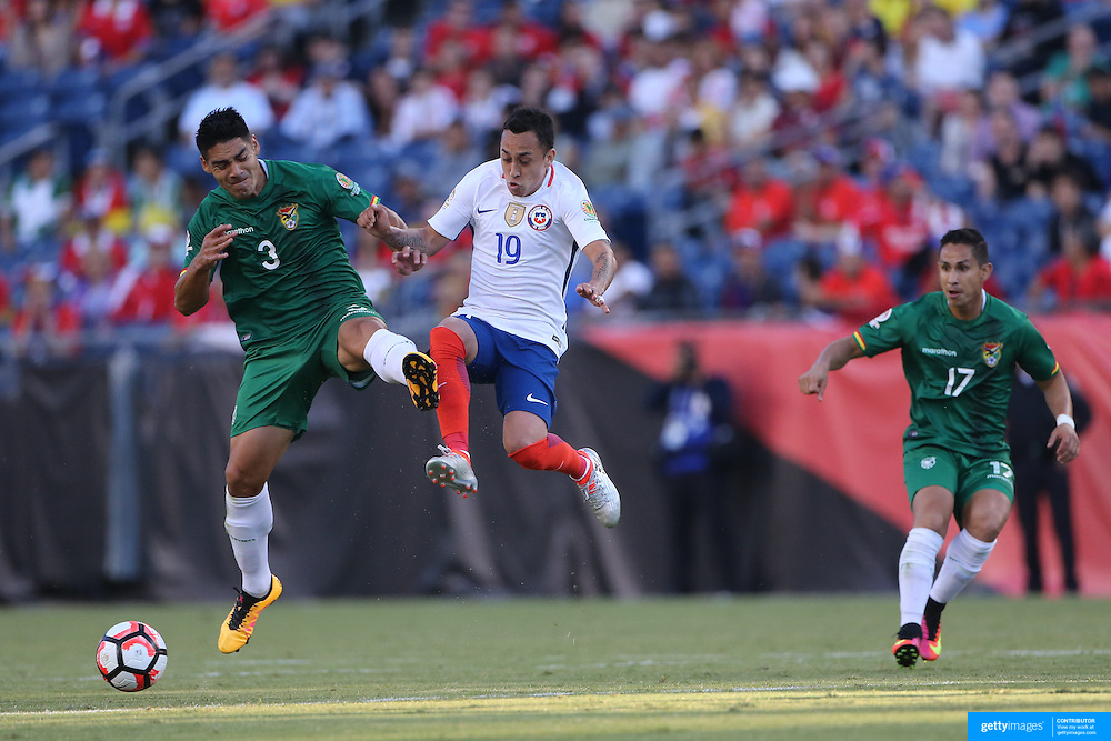 FOXBOROUGH, MASSACHUSETTS - JUNE 10:  Luis Gutierrez #3 of Bolivia and Fabian Orellana #19 of Chile challenge for the ball during the Chile Vs Bolivia Group D match of the Copa America Centenario USA 2016 Tournament at Gillette Stadium on June 10, 2016 in Foxborough, Massachusetts. (Photo by Tim Clayton/Corbis via Getty Images)