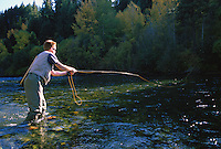 A man fly fishing in a river<br />