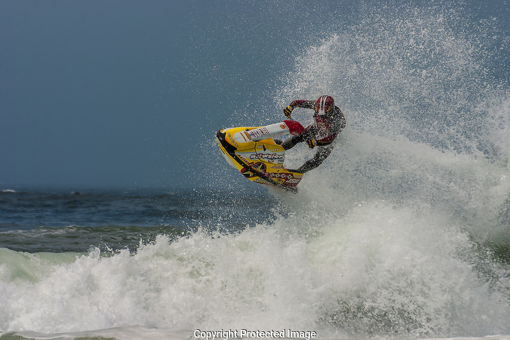 "Stand-up jet skier  Darin Anderson, known as ""Air Darin"" performs huge flips and other free ride combinations in competition at the Oregon coast"