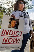 "19 JULY 2012 - PHOENIX, AZ:  An immigrants' rights supporters in front of the US Courthouse on the first day of a class action lawsuit, Melendres v. Arpaio in Phoenix Thursday. The suit, brought by the ACLU and MALDEF in federal court against Maricopa County Sheriff Joe Arpaio, alleges a wide spread pattern of racial profiling during Arpaio's ""crime suppression sweeps"" that targeted undocumented immigrants. U.S. District Judge Murray Snow granted the case class action status opening it up to all Latinos stopped by Maricopa County Sheriff's Office deputies during the crime sweeps. The case is being heard in Judge Snow's court.  PHOTO BY JACK KURTZ"