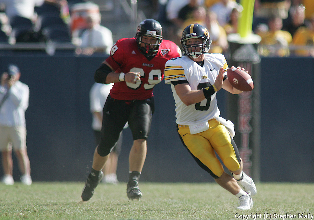 01 SEPTEMBER 2007: Iowa quarterback Jake Christensen (6) look for a receiver while running away from Northern Illinois defensive tackle Alex Krutsch (69) in Iowa's 16-3 win over Northern Illinois at Soldiers Field in Chicago, Illinois on September 1, 2007.