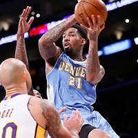 23 November 2014: Denver Nuggets forward Wilson Chandler (21) passes the ball during the Los Angeles Lakers season game versus the Denver Nuggets, at the Staples Center, Los Angeles, California, USA.