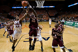 Virginia Tech forward/center Cheick Diakite (34) outreaches Virginia guard Sean Singletary (44) for a rebound.  The Virginia Cavaliers men's basketball team fell to the Virginia Tech Hokies 70-69 in overtime at the John Paul Jones Arena in Charlottesville, VA on January 16, 2008.