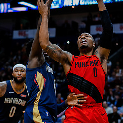 Jan 12, 2018; New Orleans, LA, USA; New Orleans Pelicans guard Jrue Holiday (11) knocks the ball from Portland Trail Blazers guard Damian Lillard (0) during the second half at the Smoothie King Center. The Pelicans defeated the Trail Blazers 119-113. Mandatory Credit: Derick E. Hingle-USA TODAY Sports