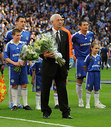 LONDON, ENGLAND - Saturday, April 18, 2009: The Football Association Chairman Lord David Triesman presents flowers to the Hillsborough Family Support Group in memory of the 96 Liverpool supporters who died at an FA Cup Semi-Final 20 years ago in 1989, before the FA Cup Semi-Final match at Wembley. (Photo by Robin Parker/Pool/Propaganda)