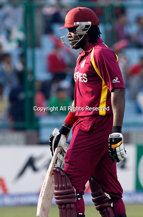 28.02.2011 Cricket World Cup from the Feroz Shah Kotla stadium in Delhi. West indies v Netherlands.Chris Gayle of West Indies  walks back after getting out during the match of the ICC Cricket World Cup between Netherlands and West Indies on the 28th February 2011
