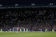 Fans hold up lights during the Sky Bet Championship Play Off First Leg match between Sheffield Wednesday and Brighton and Hove Albion at Hillsborough, Sheffield, England on 13 May 2016.