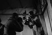NAIROBI, KENYA - NOVEMBER 14, 2011: Members of the Kibera Olympic Boxing Club train for an upcoming bout at the Joseph Kangethe Social Hall in Kibera slum.<br />