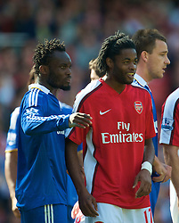 LONDON, ENGLAND - Sunday, May 10, 2009: Funny hair... Arsenal's Alexandre Song and Chelsea's Michael Essien during the Premiership match at the Emirates Stadium. (Photo by David Rawcliffe/Propaganda)
