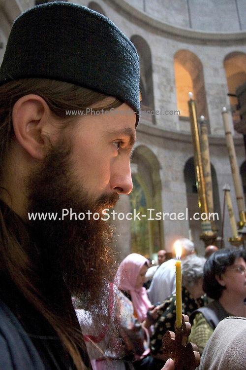 Israel, Jerusalem Old City, a prayer at the Church of the Holy Sepulchre on Good Friday. Easter 2005
