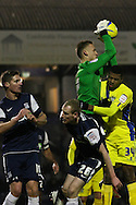 Picture by David Horn/Focus Images Ltd +44 7545 970036.11/12/2012.Daniel Bentley of Southend United saves under the challenge of Ethan Ebanks-Landell of Bury while Marc Laird and Barry Corr of Southend United look on during the The FA Cup match at Roots Hall, Southend.