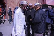 March 14, 2014- Brooklyn, NY- Men leaving Masjid Al Ihsaan, the mosque on Fulton Street in Clinton Hill, Brooklyn, after Friday midday prayer.- 3/14/2014- Rosa Goldensohn/NY City Photo Wire