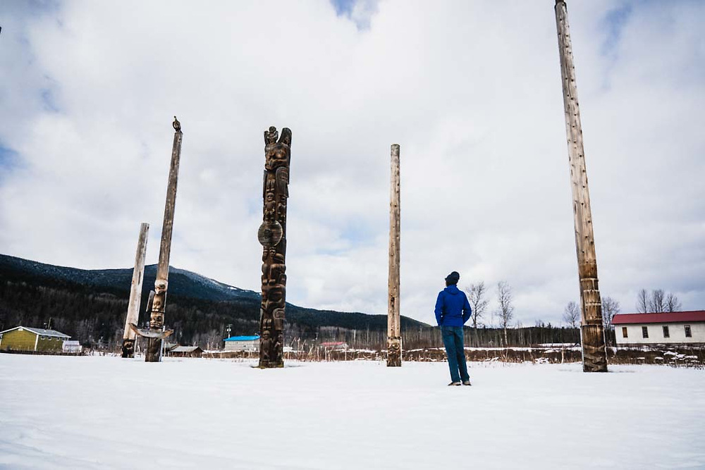 Erme Catino admires the totems of Kispiox, BC.