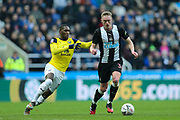 Sean Longstaff (#36) of Newcastle United on the ball being watched by Shandon Baptiste (#16) of Oxford United during the The FA Cup match between Newcastle United and Oxford United at St. James's Park, Newcastle, England on 25 January 2020.
