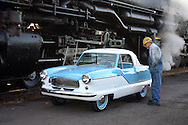 Little Nash Metropolitan parked next to the Challenger Locomotive, largest working locomotive in the world.