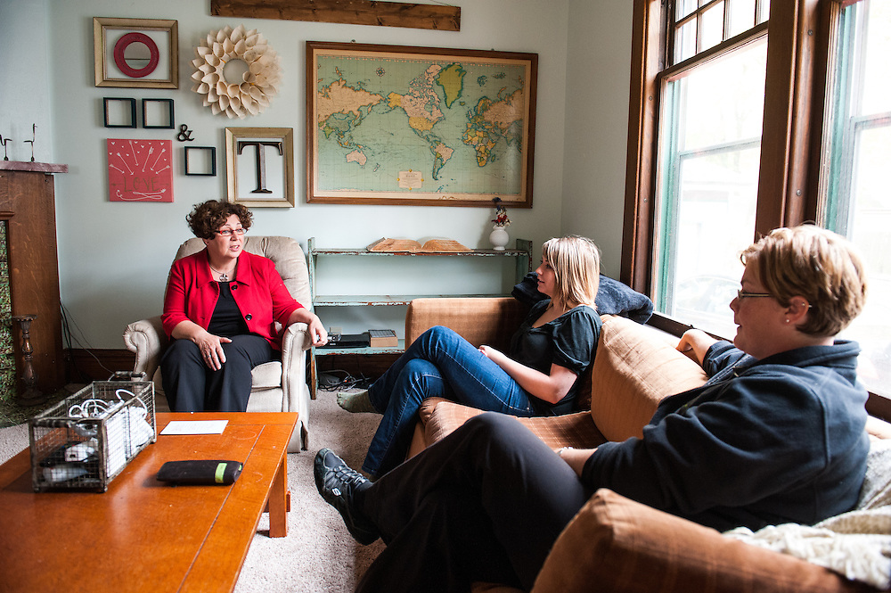 German social worker Ingrid Bethge, left, speaks with foster mother, Anna, center, under the supervision of Kelly Allen, right.