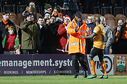 Jamel Campbell-Ryce has to be seperated from fans by fellow players and stewards at the final whistle during the EFL Sky Bet League 2 match between Barnet and Cheltenham Town at Underhill Stadium, London, England on 23 December 2017. Photo by Antony Thompson.