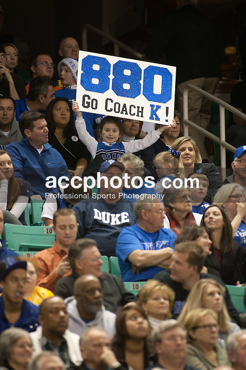 GREENSBORO, NC - DECEMBER 29: A Duke Blue Devils fans holds up a sign signifying Duke's head coach Mike Krzyzewski becoming the second all-time winningest Division I college basketball coach at 880 wins on December 29, 2010 at the Greensboro Coliseum in Greensboro, North Carolina. Duke won 108-62. (Photo by Peyton Williams/Getty Images)