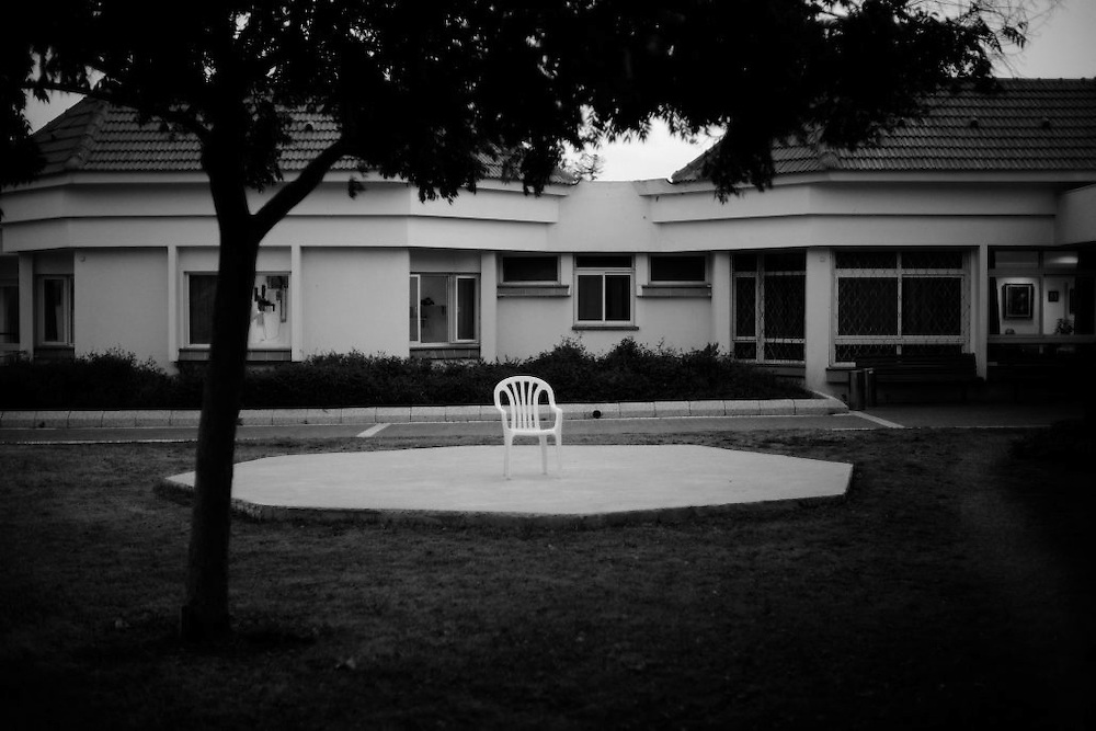 A chair is placed in the yard at Shaar Menashe Mental Health Center for Holocaust survivors in Pardes Hanna, Israel on Jan 3, 2011..