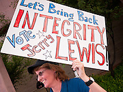06 OCTOBER 2011 - MESA, AZ: Amy McMullen (CQ) from Gold Canyon, rallies for Jerry Lewis before the debate between Jerry Lewis and Russell Pearce in Mesa Thursday. Lewis is challenging Pearce in Pearce's recall election after residents of Pearce's district signed petitions calling for the recall the President of the Arizona State Senate.  PHOTO BY JACK KURTZ