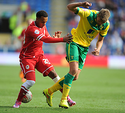 Norwich's Jos Hooiveld tackles Cardiff City's Nicky Maynard - Photo mandatory by-line: Alex James/JMP - Mobile: 07966 386802 30/08/2014 - SPORT - FOOTBALL - Cardiff - Cardiff City stadium - Cardiff City  v Norwich City - Barclays Premier League