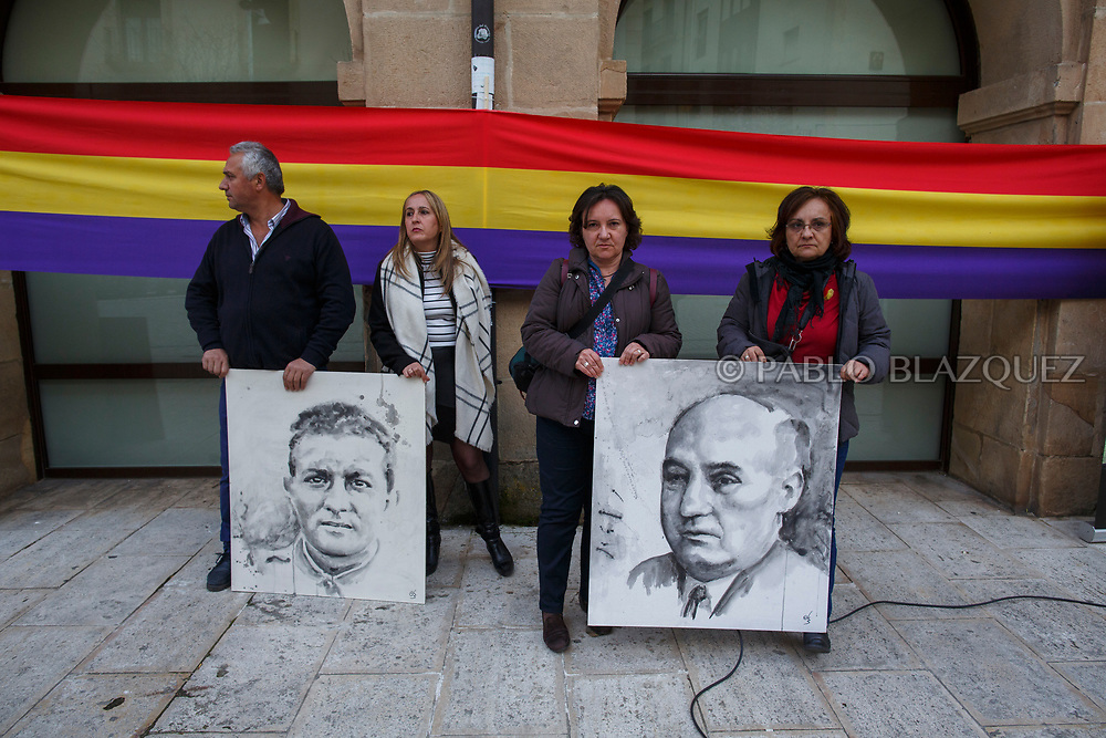 14/04/2018. Grandaughters Ana Maria (R) and Maria Luisa (2R) Andaluz Caballero hold a portrait depicting Spain's Civil War victim Abundio Andaluz and supporters hold a portrait depicting Victoriano Tarancon during a homage to hand victims of Spain Civil War bodies exhumed in Cobertelada and Calata&ntilde;azor to their relatives on April 14, 2018 in Soria, Spain. La Asociacion Soriana Recuerdo y Dignidad (ASRD) 'The Soria Association for Memory and Dignity' celebrated a tribute to hand over the remains of civil war victims to their families. The Society of Sciences of ARANZADI helped with the research, exhumation and identification of the bodies, after villagers passed the information about the mass grave, 81 years after the assassination took place, to the ASRD. Seven people were assassinated around August 25, 1936 by Falangists, as part of General Francisco Franco armed forces, and buried in the 'Fosa de los Maestros' (Teachers Mass Grave) near Cobertelada, Soria, after being taken from prison of Almazan during the Spanish Civil War. Five of them were teachers in the region, and also friends of Spanish writer Antonio Machado. The other two still remain unidentified. Another body was assassinated by Falangists accompanied by a priest in 1936, and was exhumed on 23 September of 2017 near Calata&ntilde;azor, Soria. It belonged to Abundio Andaluz, a politician, lawyer and musician in Soria.<br /> Spain's Civil War took the lives of thousands of people on both sides, and civilians. But Franco continued his executions after the war has finished. Teachers, as part of the education sector, were often a target of Franco's forces. Spanish governments has never done anything to help the victims of the Civil War and Franco's dictatorship while there are still thousands of people missing in mass graves around the country. (&copy; Pablo Blazquez)