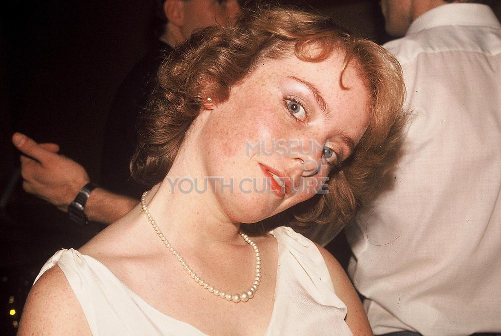 Female guest at wedding reception, London, UK, 1983