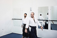 CASABLANCA, MOROCCO - 14 MAY 2016: (L-R) Brothers Ahmed (28) and Ali (32) Abdul Hakeem teach aikido to a class of students in the dojo their father Luqman founded after moving to Morocco in 1985, in Sidi Maarouf, a district of Casablanca, Morocco, on May 14th 2016.<br /> <br /> The Hakeem brothers are the sons of Luqman Abdul-Hakeem, a close follower of Malcolm X that chauffeured the African American activist around and introduced him to Cuban leader  Fidel Castro in September 1960.<br /> <br /> Born in Cleveland, OH, in 1934, Luqman Abdul-Hakeem was raised in Flushing, Queens, and then moved to Bayside, where he graduated in 1952. He attended the New York Technical University for a few months before enrolling in the Navy, where he stayed for two years. Though he had asked for ship duty, he ended up in Springfield, Mass., and Glennclose, Ill. He moved to Brooklyn when his hitch was done and by 1966 was studying jujitsu and aikido. He met Malcolm X during one of his sermons on 116th street in Harlem, New York, in the late 50's. In 1985, Mr. Hakeem decided to move to Marocco because America wasn't a country where he wanted to raise hois children. He has been teaching aikido in the two dojos he owns in Casablanca until 2014, when he underwent a surgery.
