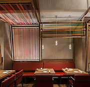 Patka Restaurant, Barcelona, Spain. Architect: El Equipo Creativo, 2013. Mid afternoon, tables are laid out.