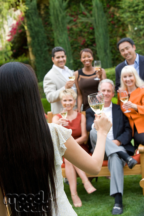 Friends toasting outdoors