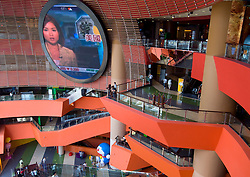 Interior of large modern shopping mall with futuristic architecture called HK Megabox in Hong Kong