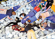 Byron Hetzler/Sky-Hi Daily News.Members of Grand County Emergency Medical Services, the East Grand Fire Department and Grand Park Community Recreation Center staff treat simulated patients during training exercises in the foam pit at the recreation center on Tuesday in Fraser.