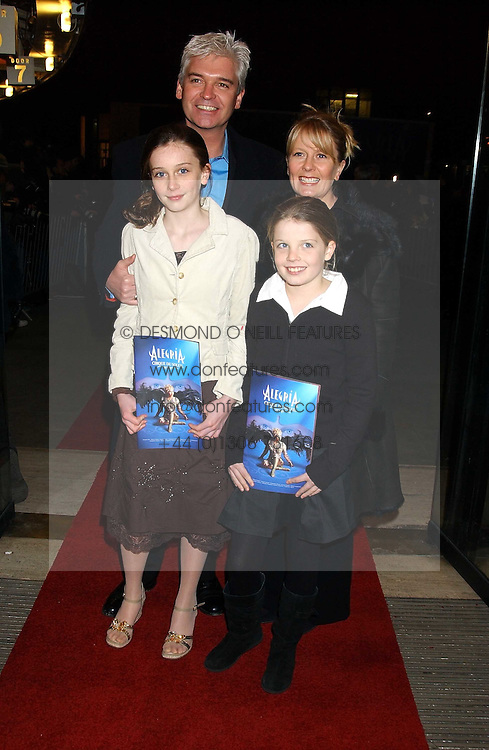 TV presenter PHILIP SCHOFIELD and his wife STEPHANIE with their children MOLLY (in white) and RUBY at the press night of Cirque Du Soleil's 'Alegria' held at the Royal Albert, London on 5th January 2006.<br />