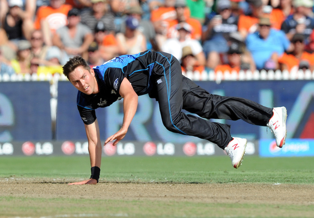 New Zealand's Trent Boult takes a tumble while bowling against Bangladesh in the ICC Cricket World Cup at Seddon Park, Hamilton, New Zealand, Friday, March 13, 2015. Credit:SNPA / Ross Setford