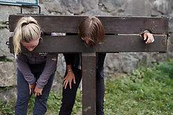 Annette Edmondson (AUS) and Alexis Ryan (USA) in the fortress stocks at Ladies Tour of Norway Team Presentation 2018, in Halden, Norway on August 15, 2018. Photo by Sean Robinson/velofocus.com