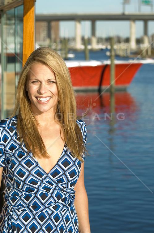 young woman standing at a marina in Charleston, South Carolina