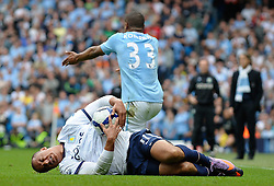 01.05.2010, City of Manchester Stadium, Manchester, ENG, PL, Manchester City vs Aston Villa im Bild Gabriel Agbonlahor of Aston Villa reacts after a challenge from Vincent Kompany of Manchester City, EXPA Pictures © 2010, PhotoCredit EXPA/ Marc Atkins / SPORTIDA PHOTO AGENCY