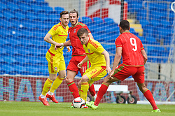 CARDIFF, WALES - Friday, June 5, 2015: Wales' Gareth Bale with Wes Burns and Declan John during a practice match at the Cardiff City Stadium ahead of the UEFA Euro 2016 Qualifying Round Group B match against Belgium. (Pic by David Rawcliffe/Propaganda)