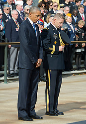 United States President Barack Obama, left, and US Army Major General Bradley A. Becker, Commander, US Army Military District of Washington, right bow their heads in prayer during a wreath-laying ceremony at the Tomb of the Unknown Soldier at Arlington National Cemetery in Arlington, Virginia on Veteran's Day, Friday, November 11, 2016.<br /> Credit: Ron Sachs / Pool via CNP