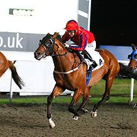 Prince Of Burma and Ian Mongan winning the 5.25 race